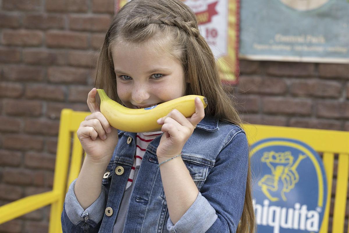 Linda smiling with Chiquita banana